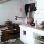 Сlay oven and baby cradle in the folk museum